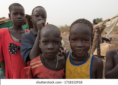 JUBA, SOUTH SUDAN - FEBRUARY 28 2012: Unidentified kids pose for pictures at displaced persons camp in Juba, South Sudan. Juba is full of refugees who live with their children in appalling conditions.