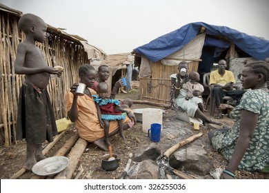JUBA, SOUTH SUDAN - FEBRUARY 28: Unidentified people have breakfast in front of their huts in displaced persons camp, Juba, South Sudan, February 28, 2012. They stay in harsh conditions for long time.