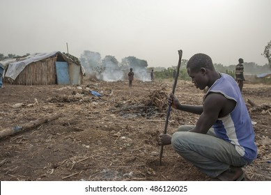 JUBA, SOUTH SUDAN - FEBRUARY 28: Unidentified refugee digs a hole for a construction of new hovel in displaced persons camp, Juba, South Sudan, February 28, 2012. People stay in harsh conditions here.