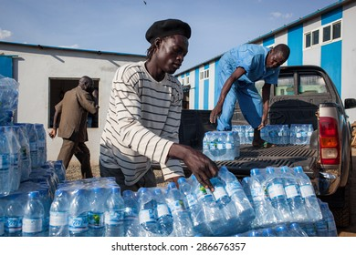 Juba, South Sudan - March 19, 2014: South Sudanese workers load bottled water in a truck