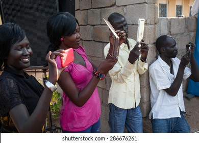 Juba, South Sudan - March 27, 2014: South Sudanese youth take photos of a theatre play