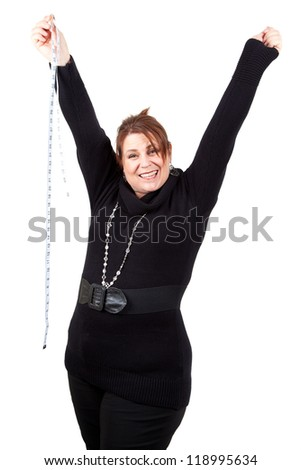 A jubilant woman raises her arms in triumph at achieving her goal.