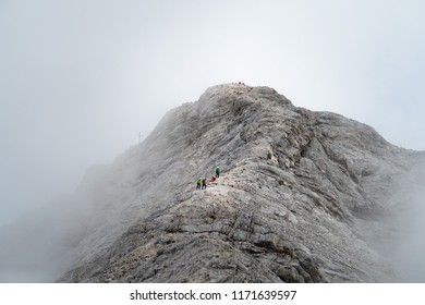 Jubilaumsgrat ridge, via ferrata, climbing leading from Alpspitze to Zugspitze (Germany, Austria), rock path covered in clouds and haze