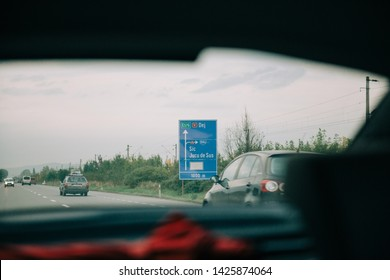 Jucu, Romania - Sep 26, 2013: View from the car at the Romanian highway street road sign featuring almost visible NOKIA sign after Nokia Finland closed the factory near Cluj in 2011
