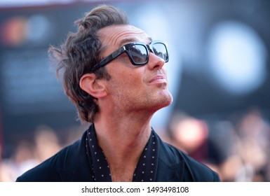 """Jude Law walks the red carpet ahead of """"The New Pope"""" screening during the 76th Venice Film Festival at Sala Grande on September 01, 2019 in Venice, Italy."""