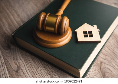 Judge auction and real estate concept. House model, gavel and law books