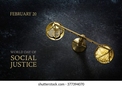 Judge balance with rice and coins on a dark slate plate, view from above, concept with text World Day of Social Justice, February 20, selected focus, narrow depth of field