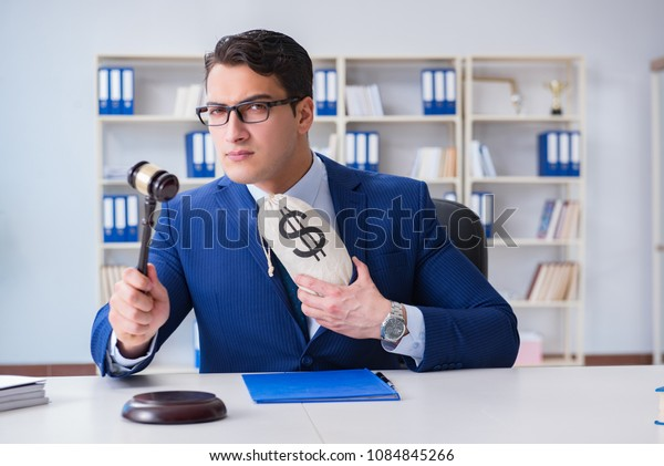 Judge in bribe concept with money