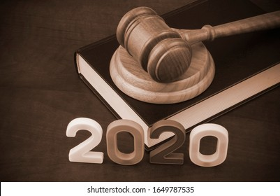 Judge gavel, book and numbers 2020. Concept new laws in year 2020.