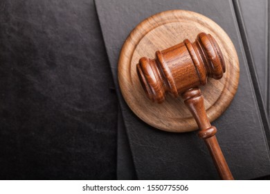 Judge gavel with books on wooden table