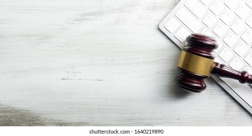 Judge gavel with computer keyboard. Concept of internet crime. Copy space for text