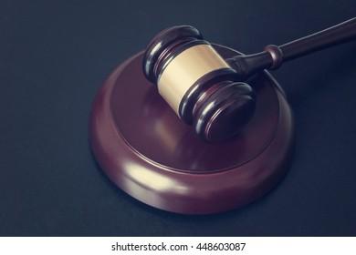 Judge gavel dark wooden table, law concept