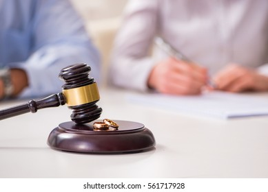 Judge gavel deciding on marriage divorce