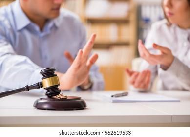 Judge gavel deciding on marriage divorce - Shutterstock ID 562619533