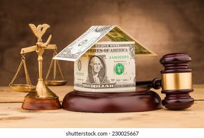 judge gavel with dollar money house closeup