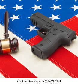 Judge gavel and gun over USA flag - self-defense law concept