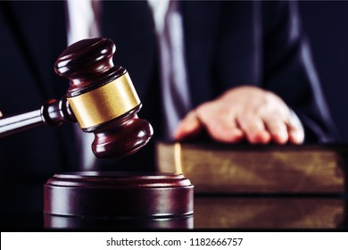 Judge Gavel And Handcuffs On Wooden Desk