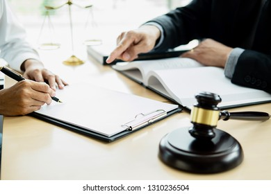 Judge gavel with Justice lawyer having team meeting at law firm with legal office background. Concepts of Law and Legal services