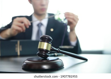 Judge gavel with justice lawyer.Businessman in suit or lawyer. Advice and Legal services Concept.