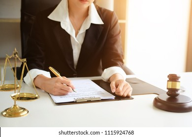 Judge gavel Justice lawyers, Business woman in suit or lawyer working on a documents. Legal law, advice and justice concept.