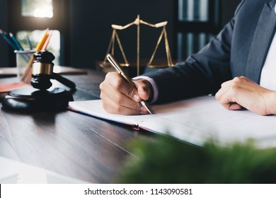 Judge gavel with Justice lawyers, Business woam in suit or lawyer working on a documents. Legal law, advice and justice concept.