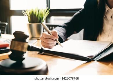 Judge gavel with Justice lawyers, Business woam in suit or lawyer working on a documents. Legal law, advice and justice concept