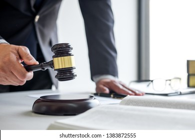 Judge gavel with Justice lawyers, Businessman in suit or lawyer working on a documents in courtroom. Legal law, advice and justice concept.