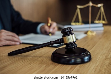 Judge gavel with Justice lawyers, Businessman in suit or lawyer working on a documents. Legal law, advice and justice concept.