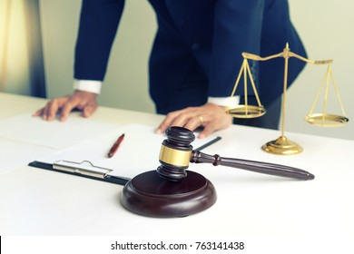 Judge gavel with Justice lawyers, Businessman in suit or lawyer working with legal law documents.