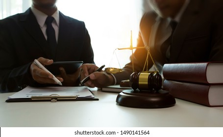 Judge gavel with Justice lawyers, Consultation of Businessman or lawyer team meeting with client, Law and Legal services concept