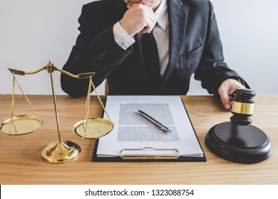 Judge gavel with Justice lawyers, counselor in suit or lawyer working on a documents at law firm in office. Legal law, advice and justice concept.