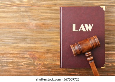 Judge gavel and Law book on wooden background