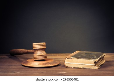 Judge gavel and law book. Symbol of justice. Old style filtered photo