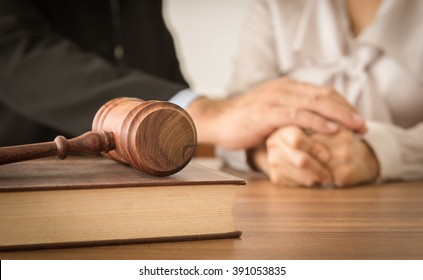 Judge gavel ,law books with attorney or lawyer provide legal advice and consoling to his clients in background. Divorce law ,Family law concept.