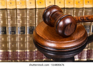 Judge gavel with law books in the background