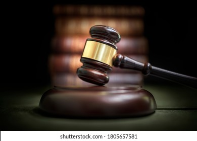 Judge gavel and law books in court background
