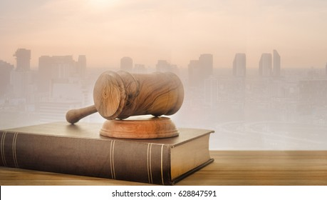 Judge gavel, law books with real estate backgroud. Concept of real estate law, property legal.