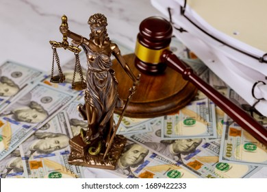 Judge gavel, lawyer office law and justice with a dollar sign corruption venality concepts