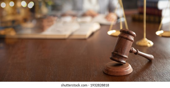 Judge gavel with lawyer team meeting at law firm. Concept of law,legal advice and services.