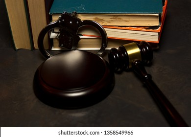 judge gavel lie besile of books and handcuffs