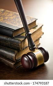judge gavel with old books on wooden background