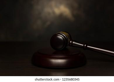 judge gavel on aged bronze background
