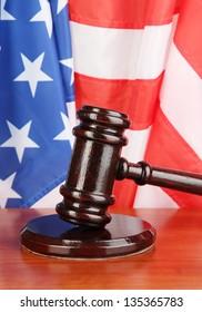 Judge gavel on american flag background