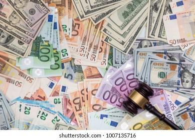 Judge gavel on dollars and euro banknotes