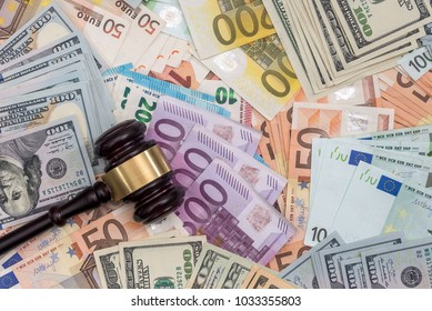 Judge gavel on dollars and euro banknotes