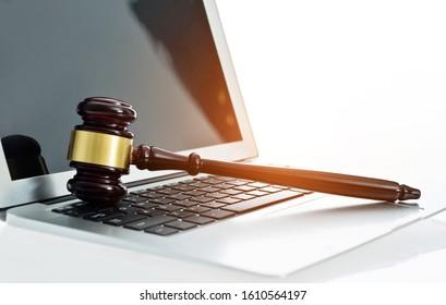 Judge gavel on laptop computer keyboard.