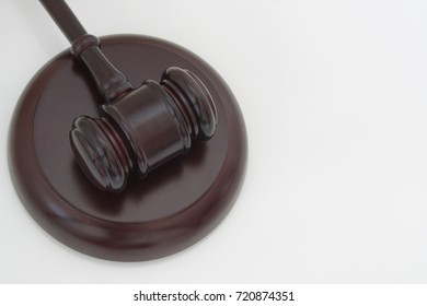 Judge gavel on white table with room for text
