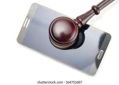 Judge gavel over neat smartphone - studio shot on white
