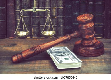 Judge Gavel, Scale Of Justice With USa Dollars And Law Book On Judges Table In Courtroom. Conceptual Image To Illustration Bail, Bankruptcy, Fee, Tax, Fraud, Monetary Penalty, Fine And Financial Fraud