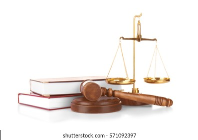 Judge gavel, scales and books on white background